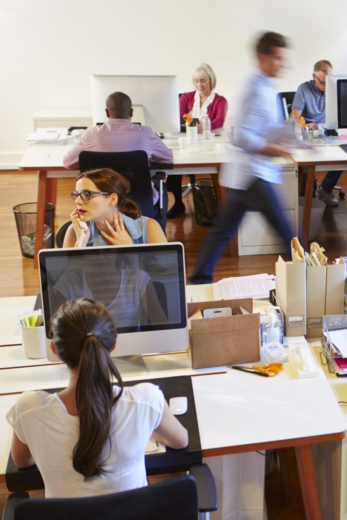 People working in an open office environment