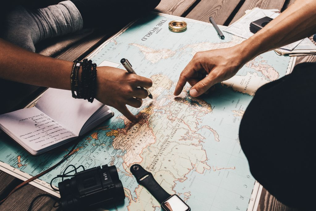 people pointing at a map